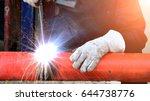 industrial worker welding at... | Shutterstock . vector #644738776