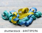 handful of measuring tapes in... | Shutterstock . vector #644739196