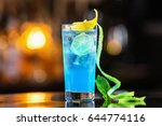 closeup glass of blue lagoon... | Shutterstock . vector #644774116