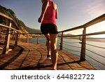 young fitness woman runner... | Shutterstock . vector #644822722