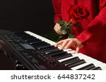 Pianist With Red Rose Playing...
