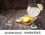 glass of gin tonic with lemon... | Shutterstock . vector #644843065