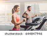 couple run on treadmills. man... | Shutterstock . vector #644847946