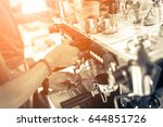 barista making coffee grinding... | Shutterstock . vector #644851726