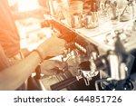 barista making coffee grinding... | Shutterstock . vector #644851726