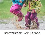 Children In Rubber Boots And...