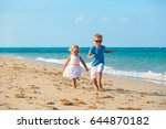little boy and girl running at... | Shutterstock . vector #644870182