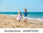 little boy and girl running at... | Shutterstock . vector #644870182