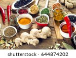 colorful spices on a wooden... | Shutterstock . vector #644874202