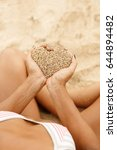hands hold sand in shape of... | Shutterstock . vector #644894482
