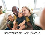 young interracial family with... | Shutterstock . vector #644896936