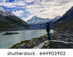 the man looking at the lake and ... | Shutterstock . vector #644903902
