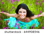 woman sitting on summer flower... | Shutterstock . vector #644908546