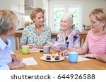Stock photo group of women meeting for book group 644926588