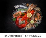 fresh tasty seafood served on... | Shutterstock . vector #644933122