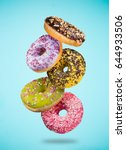 tasty doughnuts in motion... | Shutterstock . vector #644933506