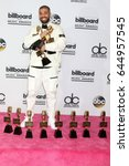 Small photo of LAS VEGAS - MAY 21: Drake at the 2017 Billboard Awards Press Room at the T-Mobile Arena on May 21, 2017 in Las Vegas, NV