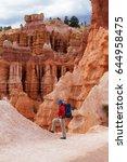 hiker visits bryce canyon... | Shutterstock . vector #644958475