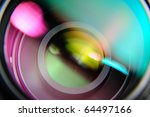 abstract closeup front of lens with pink and turquoise reflection - stock photo