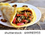 omelette with mushrooms and... | Shutterstock . vector #644985955