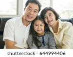 asian family happy in living... | Shutterstock . vector #644994406