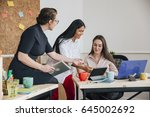 women are working together in... | Shutterstock . vector #645002692