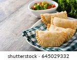 typical spanish empanadas on... | Shutterstock . vector #645029332