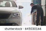 worker washes the car in... | Shutterstock . vector #645030166