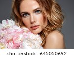 woman with flowers. beauty.... | Shutterstock . vector #645050692