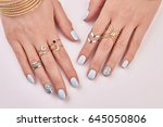 close up of female fingers with ... | Shutterstock . vector #645050806