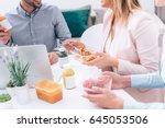 work team having lunch break | Shutterstock . vector #645053506