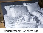 wrinkled blanket white bed and... | Shutterstock . vector #645095335