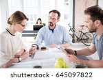 serious manager is helping... | Shutterstock . vector #645097822
