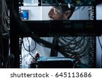handsome it administrator... | Shutterstock . vector #645113686