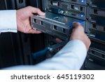 blade server being in hands of...   Shutterstock . vector #645119302