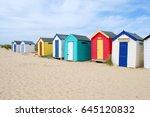 Multi Coloured Beach Hut On An...