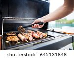 young man grills some kind of... | Shutterstock . vector #645131848