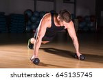 young man athlete doing pushups ... | Shutterstock . vector #645135745