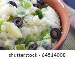 Dutch stamppot (gourmet mashed potatoes) with brussel sprouts and olives.  mmm lekker! - stock photo