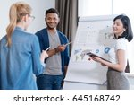 delighted positive man holding...   Shutterstock . vector #645168742