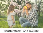 dad playing with toy camera... | Shutterstock . vector #645169882