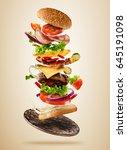 flying burger ingredients above ... | Shutterstock . vector #645191098