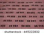 red wall background with holes | Shutterstock . vector #645222832