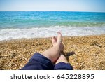 men's feet on the beach  on the ... | Shutterstock . vector #645228895