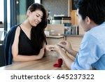 asian handsome man putting... | Shutterstock . vector #645237322