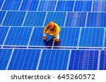 man repair of solar panels.the...   Shutterstock . vector #645260572