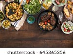 dinner table with grilled steak ... | Shutterstock . vector #645365356
