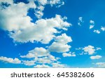 blue sky with clouds closeup | Shutterstock . vector #645382606