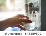 male hand serving water of a... | Shutterstock . vector #645389572