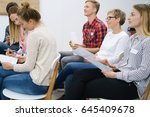 group of young students in a... | Shutterstock . vector #645409678
